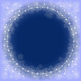 Blue background with snowflakes. Festive blue background with space for text in the center and a pattern of snowflakes on the edges Stock Photo