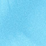 Blue background. Soft blue background with some fine grain in it Stock Image