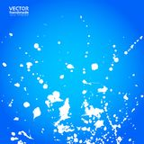 Blue background with splashes of white paint Royalty Free Stock Photo