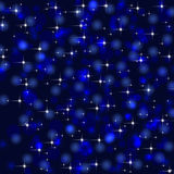 Blue background with stars and bokeh lights Stock Photography