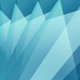Blue background with triangle shapes layered in abstract modern pattern Royalty Free Stock Photos