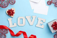 Blue background with valentine's day composition Stock Photos