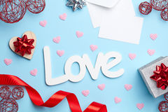 Blue background with valentine's day composition Stock Images