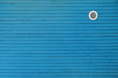 Blue background. Wall of some old house Royalty Free Stock Image