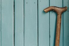 Old age and a wooden vintage cane. Background. Free place. stock image