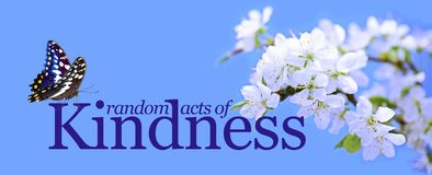 Random Acts of Kindness butterfly background. A blue background with white blossom on right and the words RANDOM ACTS OF KINDNESS and a butterfly sitting on the stock photography