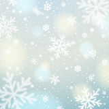 Blue  background with white blurred snowflakes, vector. Illustration Royalty Free Stock Photo