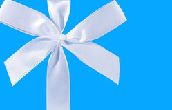 Blue background with a white bow Royalty Free Stock Photo