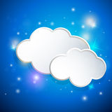 Blue background with white clouds Royalty Free Stock Images