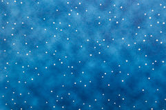Blue background with white polkadots. Blue paper with white polka dots suitable as background paper or texture overlay Stock Image