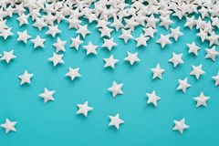 Blue background with white stars. Blue background with white glitter stars Stock Images