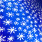 Blue background of white winter snowflakes for christmas and new Stock Photo