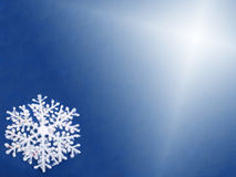 Blue Background With A White Snowflake Stock Photography