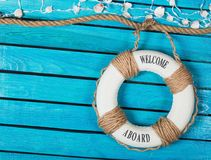 Lifebuoy with text on blue wooden background. Blue background wooden lifebuoy design travel vacations Royalty Free Stock Photos