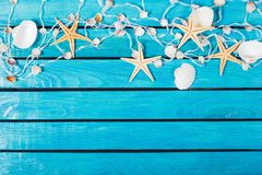 Seashells On Blue Wooden Background with place for. Blue background wooden sea wood shells seashells royalty free stock photography