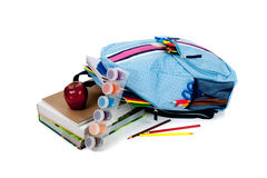 Blue backpack full of supplies on white Stock Image
