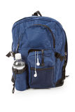 Blue backpack and water Royalty Free Stock Photos