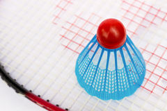 Blue badminton shuttlecock on the racket Stock Photo