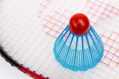 Blue badminton shuttlecock on the racket. Close up blue badminton shuttlecock on the racket, top view Stock Photo
