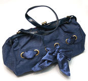 Blue bag. Blue fabric handbag with ribbon and leather handles Stock Photo