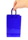 Blue bag with hand Royalty Free Stock Photography