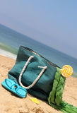 Blue bag on the seacoast with lollipop Royalty Free Stock Photography