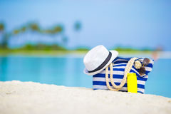Blue bag, straw hat, sunglasses and sunscreen Royalty Free Stock Photo