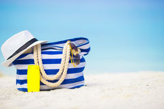Blue bag, straw hat, sunglasses and sunscreen Stock Image