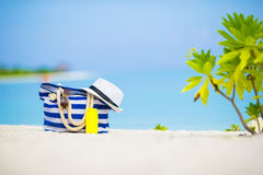 Blue bag, straw hat, sunglasses and sunscreen Stock Photos