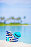 Blue bag, straw hat, sunglasses and sunscreen Royalty Free Stock Photos