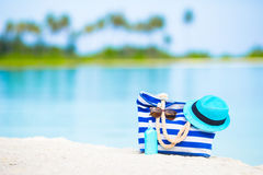 Blue bag, straw hat, sunglasses and sunscreen Royalty Free Stock Image