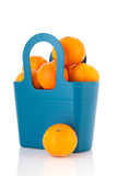 Blue bag tangerines Royalty Free Stock Photos