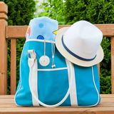 Blue bag with towel and hat for outdoor pool or beach weekend. Royalty Free Stock Image