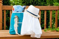 Blue bag with towel and hat for outdoor pool or beach weekend. Stock Images