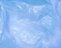 Blue bag of wrinkled plastic stock images