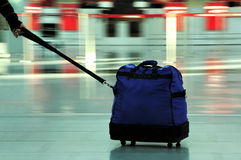 Blue Baggage In Motion Royalty Free Stock Photos