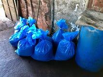 Blue bags on the floor stock photos