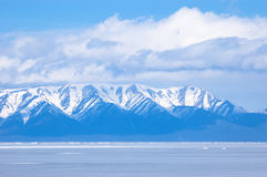 Blue Baikal mountains. Blue mountains under clouds at winter Baikal royalty free stock image