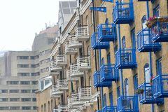 Blue balconies on warehouse conversion Royalty Free Stock Photo