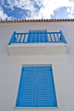 Blue balcony in streets of Skiathos island in Gree. One of the popular in Greece blue balconies on Skiathos Island stock photo