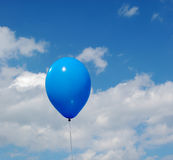 The blue ball. Flies up in the sky Royalty Free Stock Photography