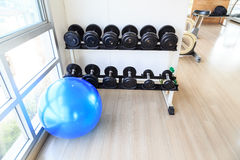 Blue ball aerobic with black dumbbell Stock Photos