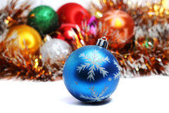 Blue ball on Christmas tree on a background of Christmas decorat Stock Photos