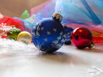 Blue ball on Christmas tree. Beautiful festive greeting card with colorful balloons and décor Royalty Free Stock Image