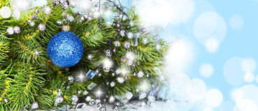 Blue ball on the Christmas tree Stock Photos