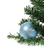 Blue ball on the Cristmas artificial fir. Royalty Free Stock Photo