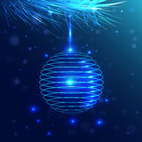Blue ball hanging on a branch fluffy. neon light Stock Photo