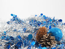 Blue ball and pine ball on the colorful streamer Royalty Free Stock Photo
