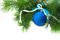 Blue ball with ribbon and Christmas-tree branch Stock Photo
