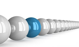 Blue ball in row of white ones, perspective Stock Image